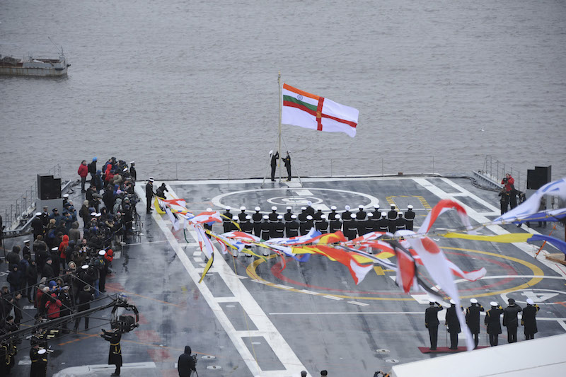Indian Navy flag is hoisted on INS Vikramaditya as it is commissioned into Indian Navy, at Sevmash Shipyard in Russia